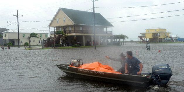 MYRTLE GROVE, LA - SEPTEMBER 3:  Plaquemines Parish emergency workers rush to lay out tubes to be filled with water to height