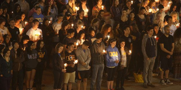 LOS ANGELES , CA - MAY 26:  Students of UCSB and UCLA mourn at a candlelight vigil at UCLA for the victims of a killing rampa