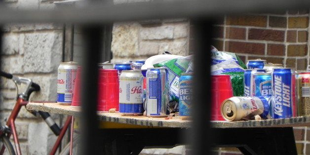 Empty beverage containers on a makeshift table in the courtyard of a Madison, Wisconsin fraternity house across from Badger s