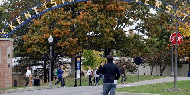 Students walk the campus at Kent State University in Kent, Ohio Wednesday, Oct. 15, 2014. Students and staff at the were noti