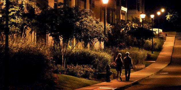 CHARLOTTESVILLE, VA- SEPTEMBER 19: A couple walks on the sidewalk after 2am at the apartment complex where Hannah Graham lived in Charlottesville. Photos depict the route (as captured by surveillance cameras) thought to be where the lasting sightings of Hannah Graham occurred. Images were made in the early a.m. hours after midnight to approximate the conditions under which she was last seen. She went missing in downtown last Saturday morning. (Photo by Michael S. Williamson/The Washington Post via Getty Images)