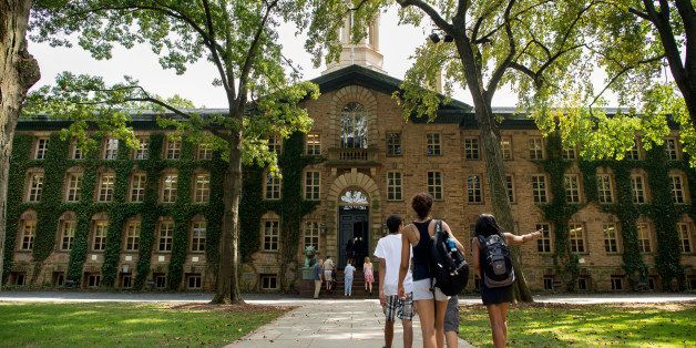 People walk on the Princeton University campus in Princeton, New Jersey, U.S., on Friday, Aug. 30, 2013. Residents in Princet