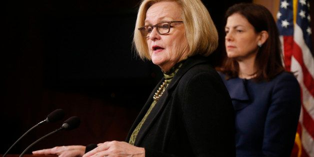 Sen. Claire McCaskill, D-Mo., left, and Sen. Kelly Ayotte, R-N.H., participate in a news conference on Capitol Hill in Washin