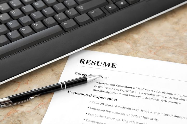 closeup of resume with pen and...