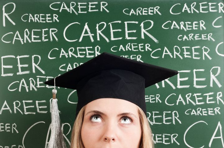 thinking young woman student in front of 'career' words written blackboard