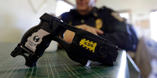 In this Nov. 14, 2013 photo, a Taser X26 is shown as Knightstown Police Chief Danny Baker talks about being shot by the weapo