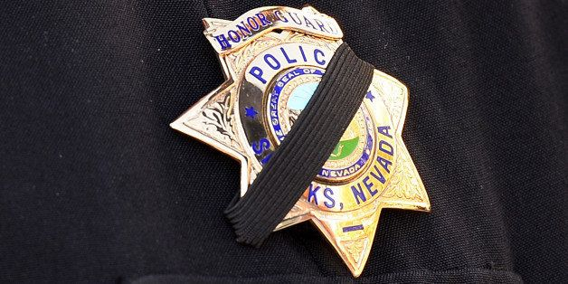 LAS VEGAS, NV - JUNE 14: Sparks Police Department Lt. and honor guard coordinator Pete Krall wears a badge with a black ribbon across it as he waits for the start of the funeral for Las Vegas Metropolitan Police Department Officer Alyn Beck at The Smith Center for the Performing Arts on June 14, 2014 in Las Vegas, Nevada. Police said Beck and Officer Igor Soldo were shot and killed on June 8 at a restaurant by Jerad Miller and his wife Amanda Miller. Police said the Millers then went into a nearby Wal-Mart where Amanda Miller killed Joseph Wilcox before police killed Jerad Miller and Amanda Miller killed herself. (Photo by Ethan Miller/Getty Images)