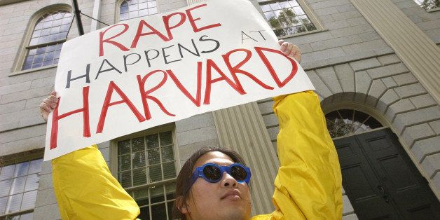 Austin Lin, a Harvard University graduate, class of 1989, from Cambridge, Mass., joins a rally Wednesday, May 15, 2002 outsid