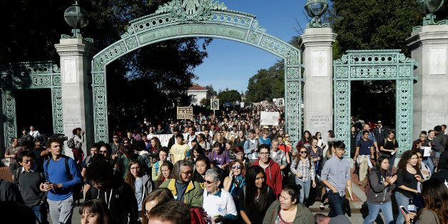 Students march under Sather Gate during a protest about tuition increases at the University of California Berkeley in Berkele