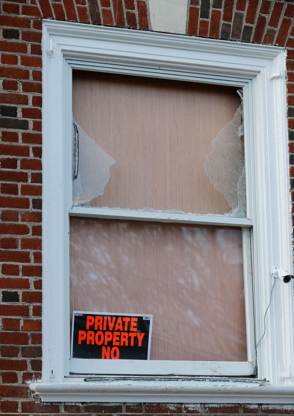 A window is boarded up at the Phi Kappa Psi fraternity house at the University of Virginia in Charlottesville, Va., Monday, N