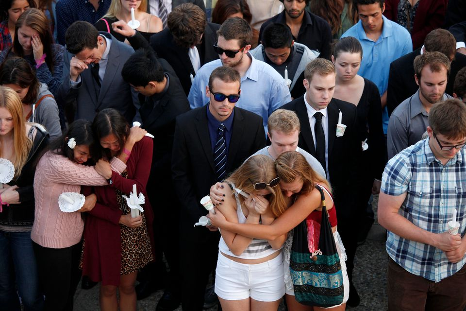 SANTA BARBARA, CA - MAY 24, 2014: Students gather on the UC Santa Barbara campus for a candlelight vigil for those affected b