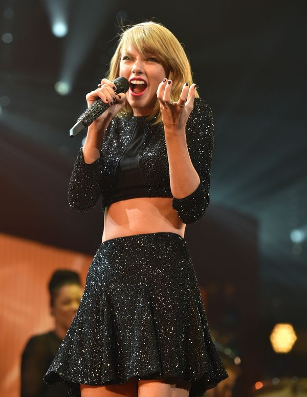Tay looks festive in this black sequin two-piece.
