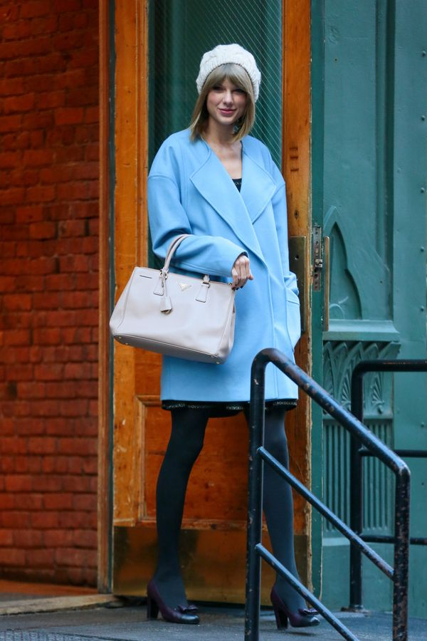 Prada bag? Check. Gorgeous oversized blue coat? Check. Perfect winter style? Check.