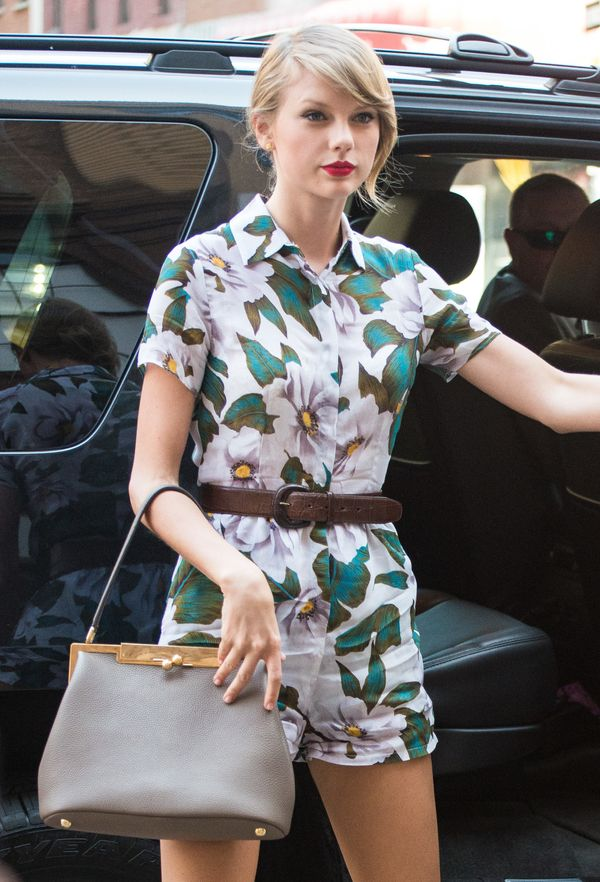 Tay kills it in a floral jumpsuit and a dainty purse.