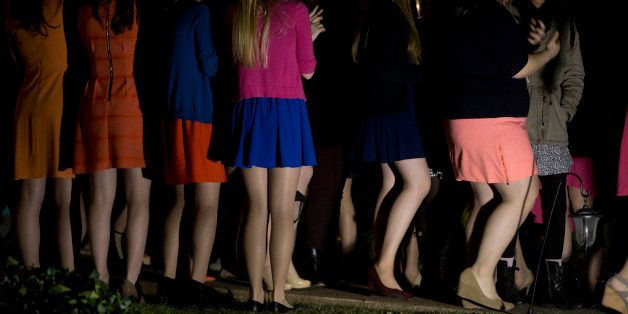 Sorority sisters clap as potential new members leave the house during spring fraternity rush near the University of Virginia