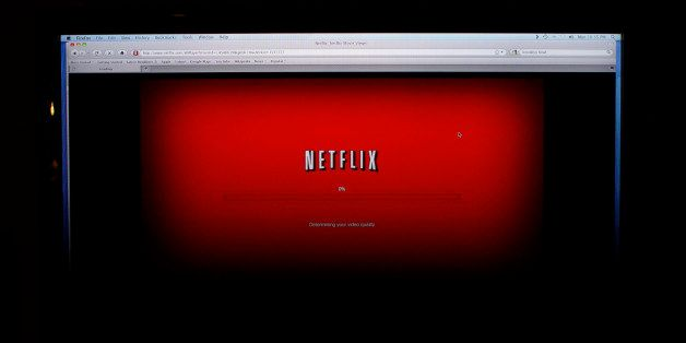 """FILE - In this Nov. 22, 2010 photo, a movie selected from among Netflix's """"Watch Instantly"""" titles begins to download on a ho"""