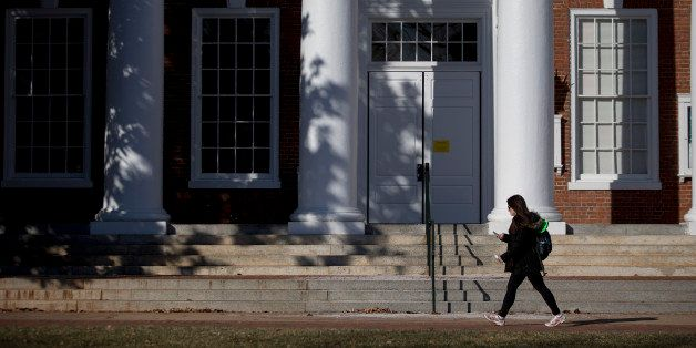 A student walks past Peabody Hall on the University of Virginia (UVA) campus in Charlottesville, Virginia, U.S., on Saturday,
