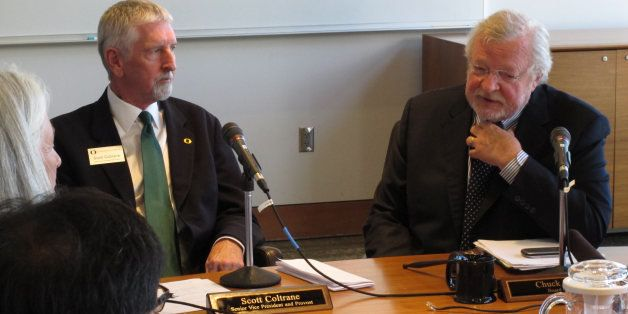 University of Oregon Interim President Scott Coltrane, left, and Board of Trustees Chairman Chuck Lillis speak to reporters o