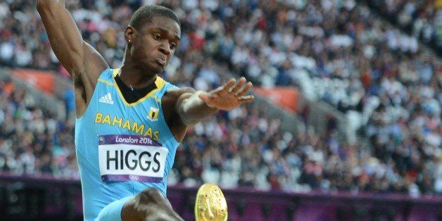 Bahamas' Raymond Higgs competes in the men's long jump qualifying rounds at the athletics event during the London 2012 Olympi
