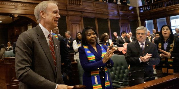 Illinois Gov. Bruce Rauner enters the House to applause to delivers his first budget address to a joint session of the Genera