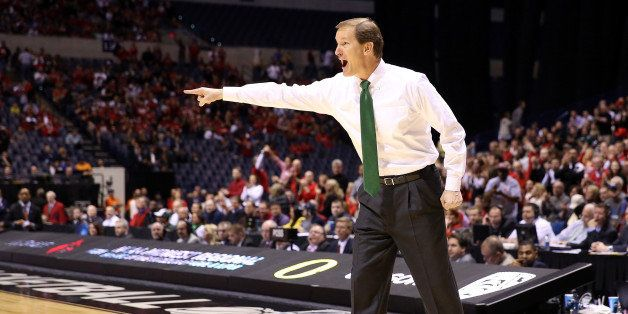 INDIANAPOLIS, IN - MARCH 29:  Head coach Dana Altman of the Oregon Ducks reacts as he coache sin the first half against the L