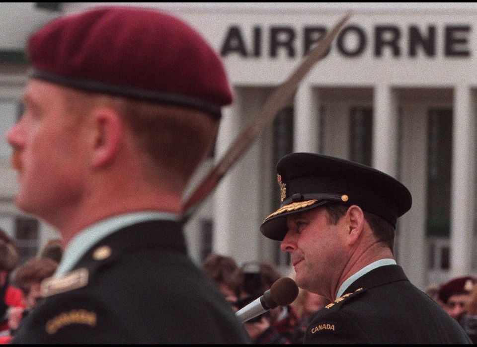 Chief of Defence Staff John de Chastelaine addresses the Canadian Airborne Regiment while Lt.-Col. Peter Kenward (L) stands a