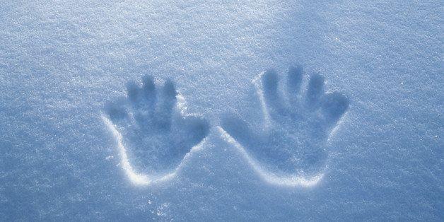 Handprints in fresh snow, winter