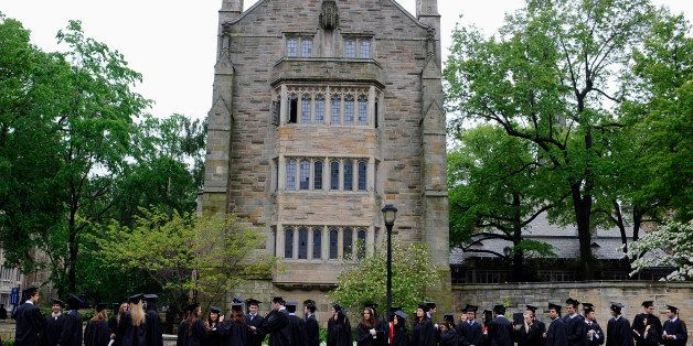 Future graduates line up for commencement on campus of Yale University in New Haven, Conn., Monday, May 20, 2013. (AP Photo/J