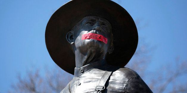 NORMAN, OK-  MARCH 11:  Tape with the word 'UNHEARD' covers the mouth of the sculpture 'The Sower' at the University of Oklah