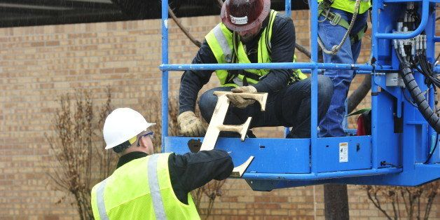 Facility workers removed the letters from the Sigma Alpha Epsilon house at the University of Oklahoma on Monday, March. 9, 20