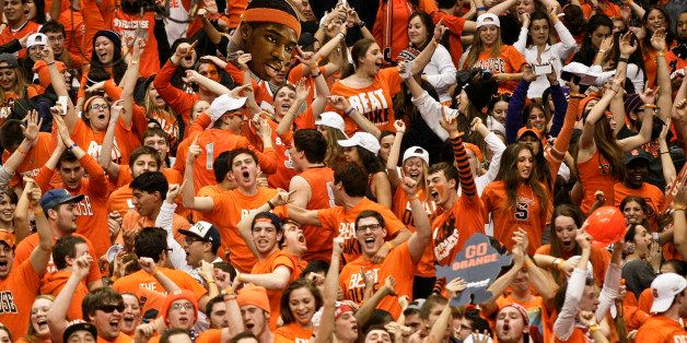 FILE - In this Feb. 1, 2014 file photo, Syracuse fans celebrate after the team defeated Duke in an NCAA college basketball ga