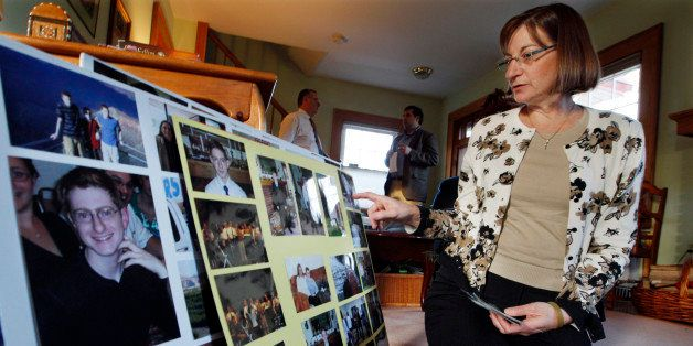 In this Dec. 9, 2011 photo, Jane Clementi looks at family photographs at her home in Ridgewood, N.J. Jane Clementi , the moth