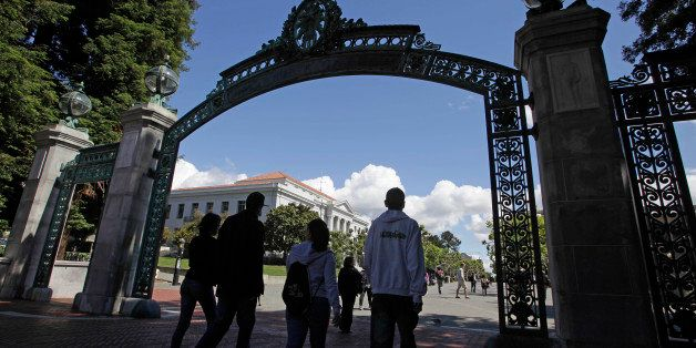 File - In this June 1, 2011 file photo a group of students walk through the Sather Gate on the University of California, Berk