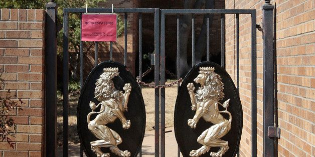 NORMAN, OK-  MARCH 11:  The front gates are chained at the Sigma Alpha Epsilon fraternity on March 11, 2015 in Norman, Oklaho