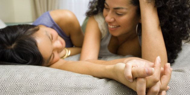 Women lying down on bed