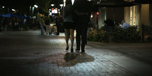 CHARLOTTESVILLE, VA - OCTOBER 02:  A couple walk through the Downtown Mall October 2, 2014 in Charlottesville, Virginia. Eigh