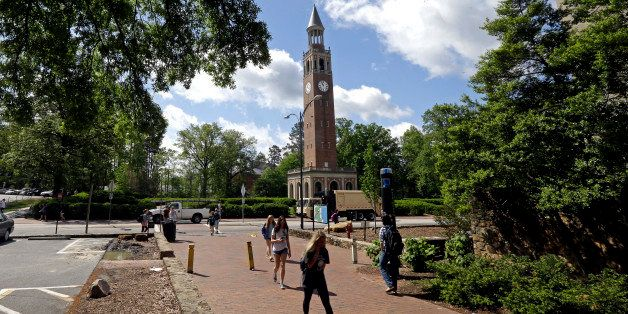 In this photo taken Monday, April 20, 2015, the Bell Tower looms over students on campus at The University of North Carolina