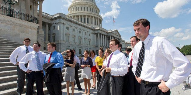 College students wait by the steps of the House of Representatives for Speaker of the House John Boehner, R-Ohio, and GOP lea