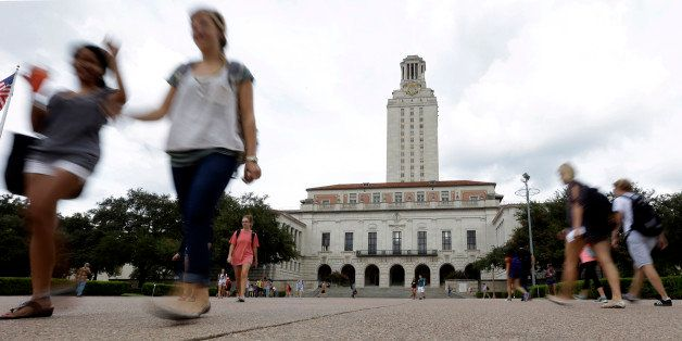 FILE - In this Sept. 27, 2012 file photo, students walk through the University of Texas at Austin campus near the school's ic