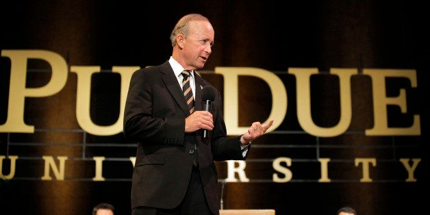 Indiana Gov. Mitch Daniels answers question during a news conference after being named as the next president of Purdue Univer