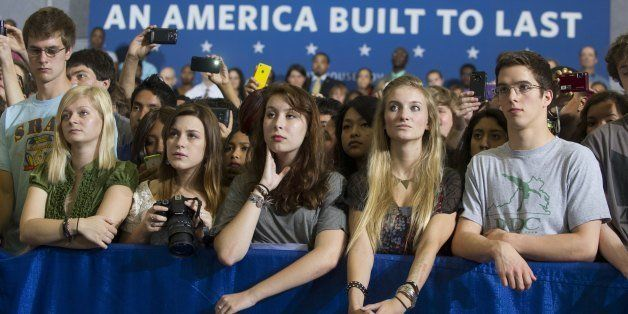 Junior and senior high school students listen as US President Barack Obama speaks on the interest rates of federal subsidized