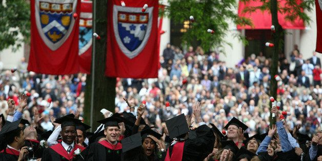CAMBRIDGE, MA - JUNE 5:  Harvard University Medical School graduates celebrate at commencement ceremonies by tossing 'giant p