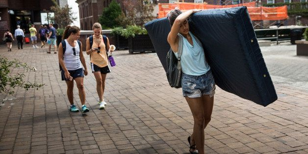 NEW YORK, NY - SEPTEMBER 05:  Emma Sulkowicz, a senior visual arts student at Columbia University, carries a mattress in prot