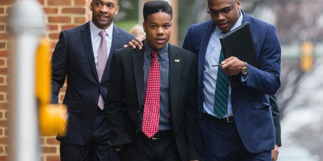 CHARLOTTESVILLE, VA - MARCH 26: University of Virginia student Martese Johnson (C) and his lawyer, Daniel Watkins (R) walk to