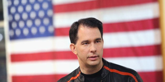 DES MOINES, IA - JUNE 06:  Wisconsin Governor Scott Walker gets ready to participate in a Roast and Ride event hosted by fres