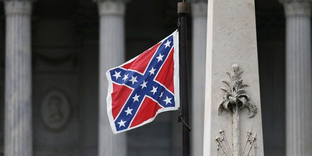 COLUMBIA, SC - JUNE 22:  The Confederate flag flies on the Capitol grounds after South Carolina Gov. Nikki Haley announced th
