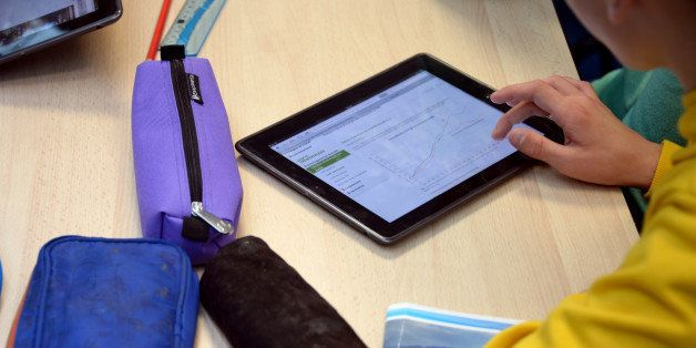 A pupil uses a tablet during courses in a classroom at the Leonard de Vinci 'connected' middle school in Saint-Brieuc, wester