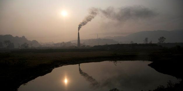 Smoke rises from a brick kiln on the outskirts of Gauhati, India, Monday, Jan. 26, 2015. The White House is hoping that the s