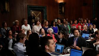 WASHINGTON, DC - SEPTEMBER 28: Female members of the House of Representatives stand up to protest during a Senate Judiciary Committee meeting September 28, 2018 in Washington, DC. The committee met to discuss and later vote on the nomination of Judge Brett Kavanaugh to the U.S. Supreme Court prior to the nomination proceeding to a vote in the full U.S. Senate. (Photo by Win McNamee/Getty Images)