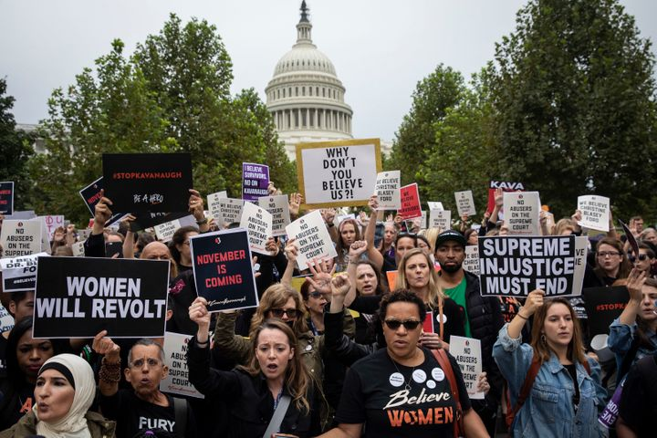 Protesters unite against Supreme Court nominee Brett Kavanaugh in a march on Capitol Hill on Sept. 27, 2018.